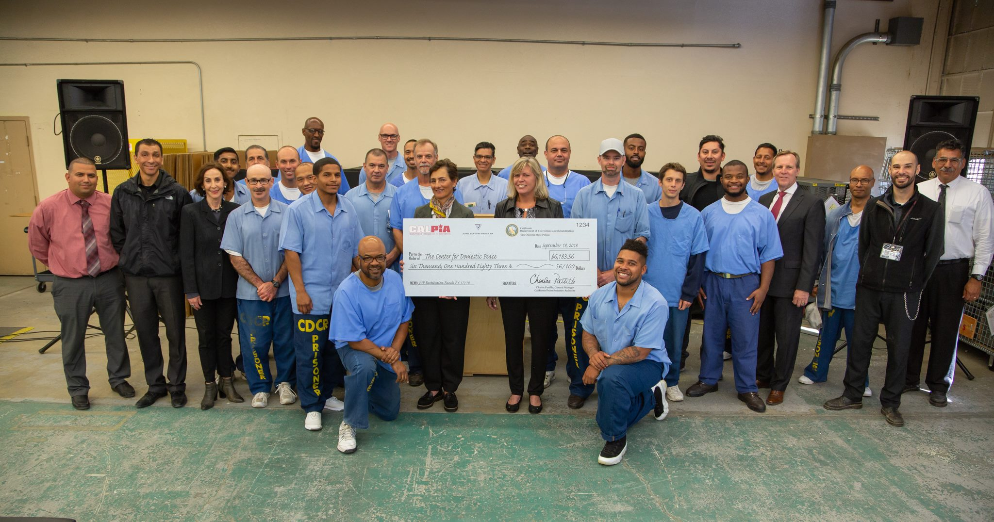 Joint Venture Program - incarcerated individuals posting a group picture